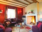 Warm and stylish sitting room overlooking La Chartreuse du Maine vegetable garden