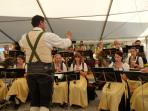 Village band play free open air concerts traditional & modern every week in the village square