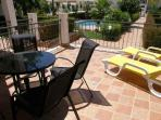Terrace overlooking the pool and gardens