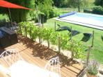 Sundeck over looking the 10x5m pool, with 8 seater table and sun loungers