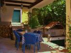 Original barbeque in Mediterranean garden (vines, figs, pomegranates, oranges and lemons)