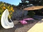 Garden furniture by the pool