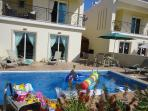Portokalia's stunning private pool and garden with lots of toys for the children.