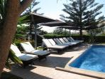 Sun loungers at pool area
