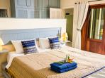 Main bedroom en suite opens out to the salt water swimming pool.