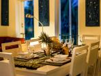 Enjoy a romantic dinner in a tropical setting.