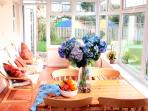Enjoy breakfast in the sun-drenched garden room