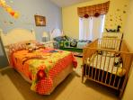 The 4th bedroom with 2 full size Twin beds and crib