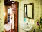 Our small but cozy bathrooms made of natural stone (slate floor and sandstone-tiled walls)