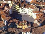 Aerial view of Lucca Amphitheatre, 50 mins away