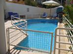 Pool showing removable railings & steps into pool