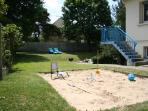 Relax on the sun loungers whilst the kids play in the sandpit