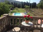 First floor balcony overlooking garden, swimming pool and vineyard