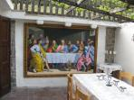 Outdoor dining area with 'The Last Supper'. Very romantic in the summer evenings.
