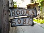 A local artisan hand crafted me this sign which hangs on the street side of the house