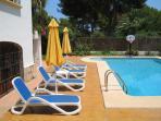 Poolside Sunbeds & Parasols