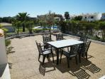 private terrace with pool access and barbecue