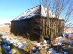 Snowy traditional fishermen hut by Beadnell beach