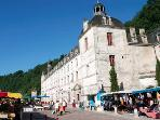 Brantome Abbey with market stalls