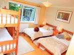 Ideal family room with twin beds and a set of bunks