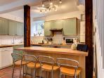 Fully equipped kitchen with breakfast bar