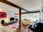 Large open plan sitting area with piano for our more musical guests