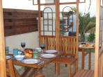 BBQ and pergola area in the afternoon