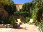 Beautiful, private walled lower garden with loungers and splash pool