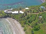 Two Bays with infinity pool (blue roof)  - above Cabier Ocean Lodge - just 100 yards from the beach