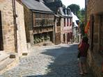 Picturesque Rue du Petit Fort in Dinan leading down to the old Port.