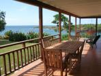 The front veranda with swing seat looking towards Crochu Bay - dining with a view