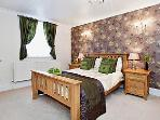Double bedroom, tastefully decorated in green