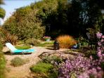 Gravel garden and riverside patio
