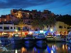 Puerto Cabopino marina and restaurants at night