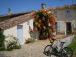 Front of La Maison Fleurie with one of the four bikes
