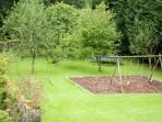 View of orchard, swings and trampoline from master bedroom