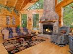 Gas log stone fireplace in this 1 bedroom log cabin between Pige
