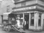 Historic photo of The Old Bakery - Mr & Mrs Chalkley with their delivery cart (minus the horse!)
