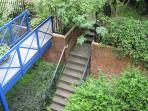 Bridge & stairs leading through Cordiner's Land's terraced courtyard gardens.