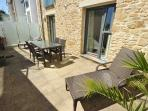 At the rear of the property, you have a private sun terrace area accessible via both bedrooms