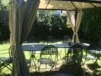 1000 m² garden with tables,  chairs and  deckchairs