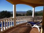 Wide balcony overlooking the pool with the Pyrenees in the distance
