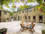 Millers Den leads out onto this lovely courtyars at Wolfen Mill