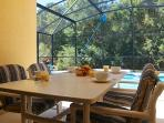 Alfresco dining on the lanai overlooking the pool