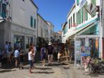 One of shopping streets leading up from La Flotte harbour