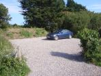 The holiday cottage has its own parking area
