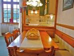 The fitted galley kitchen and cosy dining area are ideal for cooking some locally cought fish