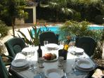 Enjoy lunch by the pool,all lit up in the evening for dinner