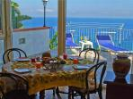 View from the breakfast table over terrace and ocean beyond