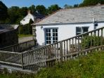 Siblyback Cottage has a fenced in private patio which is a total suntrap